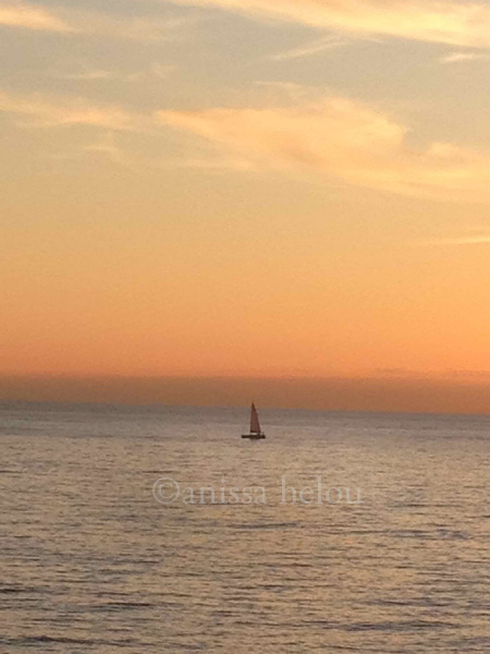 beautiful sunset with a sailboat on its way to elba copy