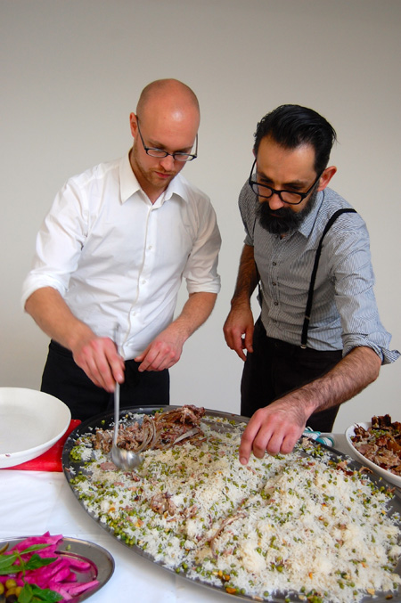 birthday picnic-arno & christian serving the rice with the lamb