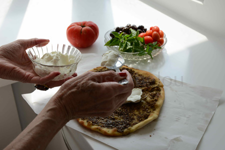 balluneh-mom putting labneh on manqusheh copy