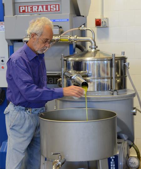sicily-tonino preparing to taste oil copy