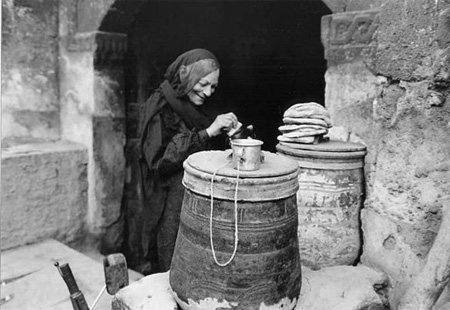 old woman stopping 4 water after buying bread copy