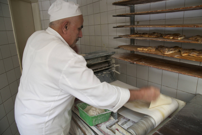 l-emile's bakery-rolling out dough for manaqish copy