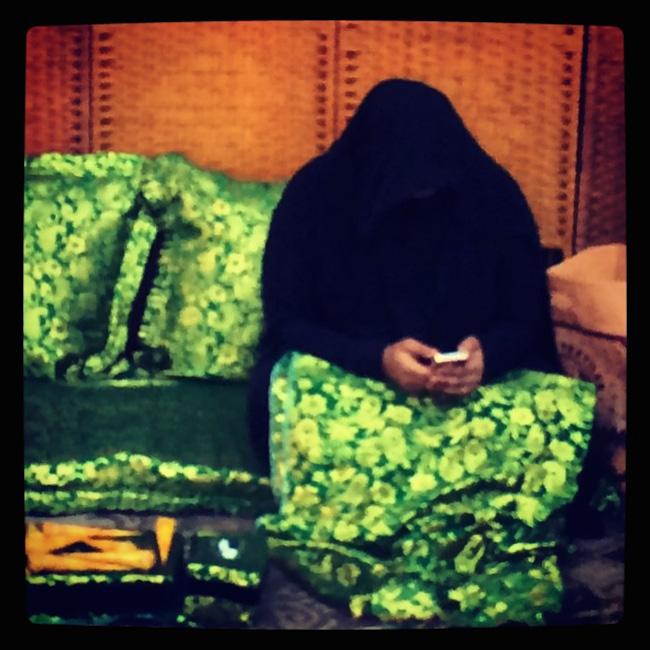 doha-veiled lady reading a text copy