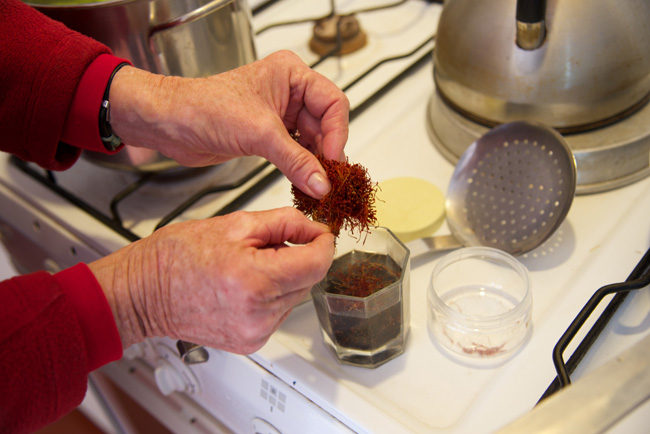 adding the saffron to the raisins soaking water